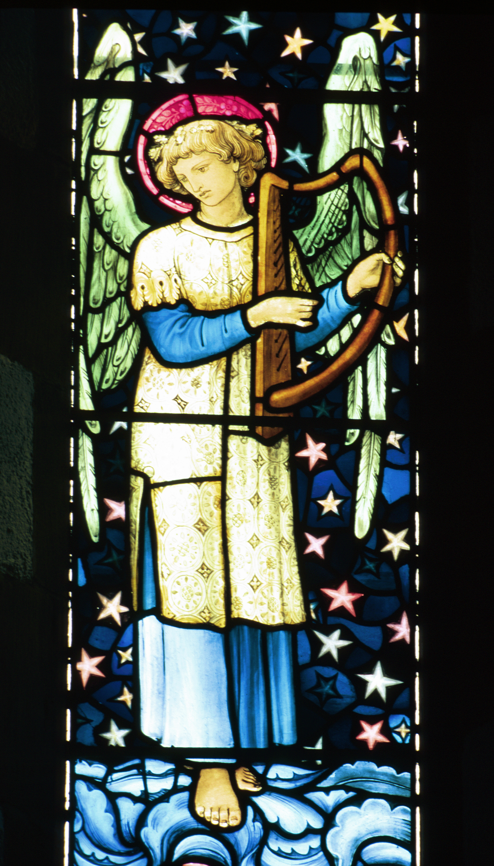 Musical Angel in stained glass by William Morris
